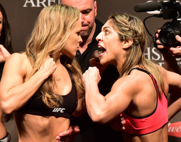 Jul 31, 2015; Rio de Janeiro, RJ, Brazil; Ronda Rousey  (left) and Bethe Correia (right) face off during weigh-ins for UFC 190 at HSBC Arena. Mandatory Credit: Jason Silva-USA TODAY Sports